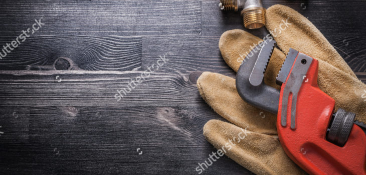 stock-photo-monkey-wrench-brass-plumbing-fittings-leather-safety-gloves-construction-concept-345646652